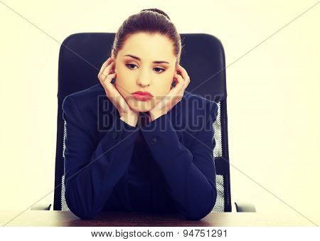 Worried young beautiful blonde businesswoman