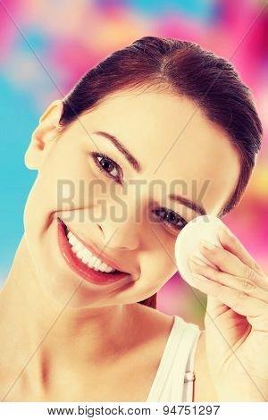 Happy woman removing make up