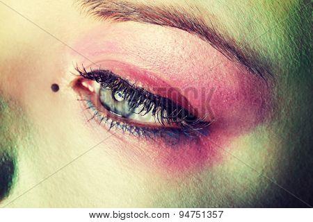 Beautiful woman with art make-up