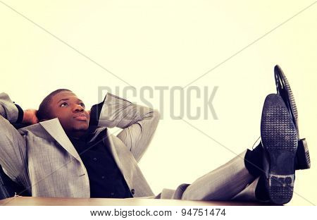 Black handsome man relaxing in the office