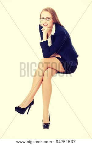 Beautiful young blonde businesswoman sitting