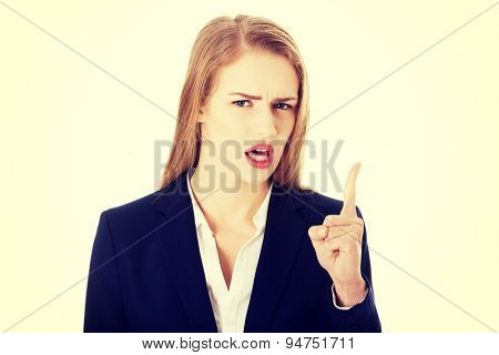 Young angry businesswoman explaining something