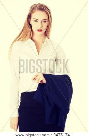 Blonde businesswoman holding her jacket