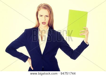 Young businesswoman holding a note