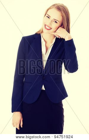 Businesswoman gestuirng phone by hand