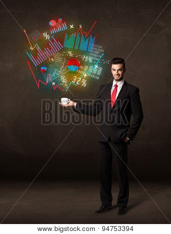 Businessman standing and holding a white cup with diagrams and graphs coming out of the cup