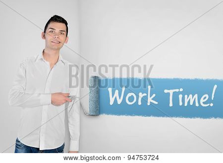 Young man painting Work time  word on wall
