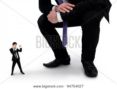 Isolated little business man fighting with boss