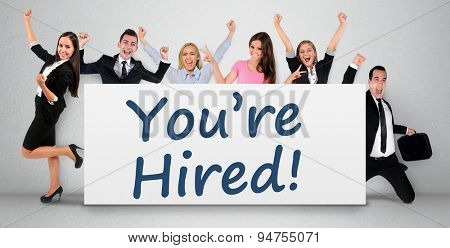 You are hired word writing on banner