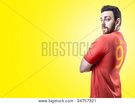 Spanish soccer player on yellow background