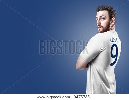 American soccer player on blue background