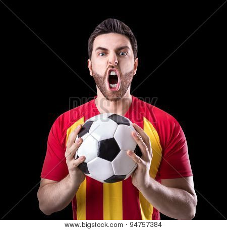 Fan on red and yellow uniform celebrates on black background