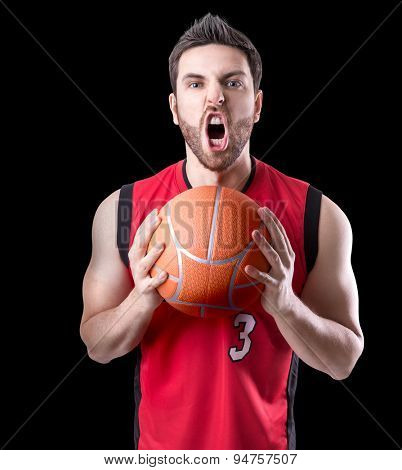 Basketball Player on a red uniform isolated on black background
