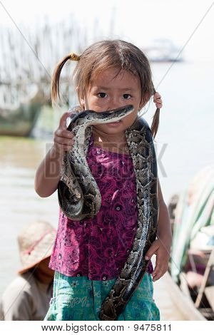 Girl of Cambodia with snake