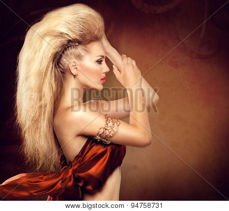 High Fashion Model Girl with Mohawk hairstyle. Beauty woman with glamour updo hair style. Blonde Slim Lady