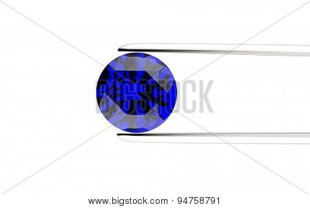 Round shape gemstone in the tweezers on a white background