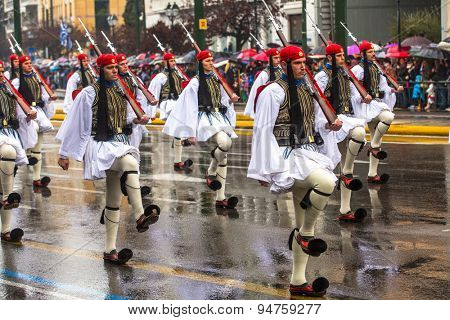 ATHENS, GREECE - MAR 25, 2015: Greek soldiers Evzones dressed in full dress uniform during Independence Day of Greece, on this day, Greeks pay tribute to the heroes of Revolution 1821-1829.