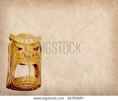 Wooden african mask on old pape