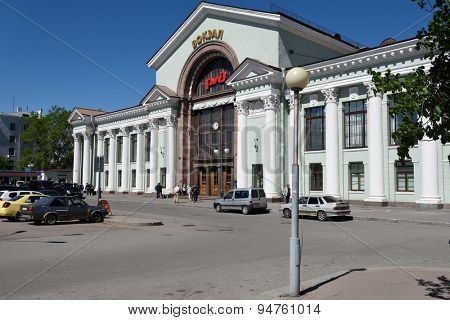 VYBORG, LENINGRAD OBLAST, RUSSIA - JUNE 6, 2015: People in front of the train station in a summer day. The station was built in 1950s instead of the building demolished in WWII