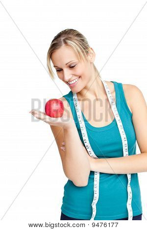 Woman With Red Apple And Measuring Tape