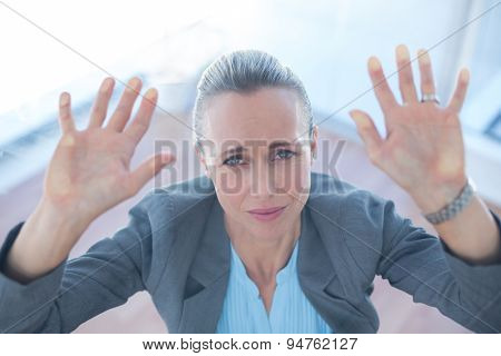 Businesswoman feeling trapped in an office