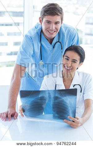 Team of doctors analyzing xray in medical office
