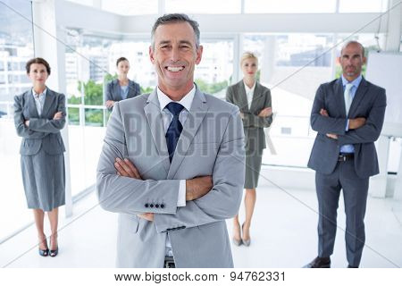 Businessman colleagues arm crossed in the office