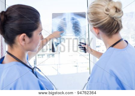 Doctors looking at Xray in medical office