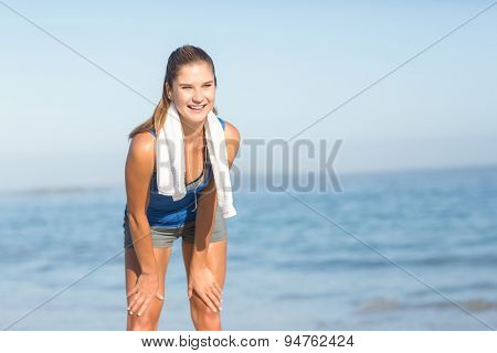 Beautiful fit woman doing break at the beach