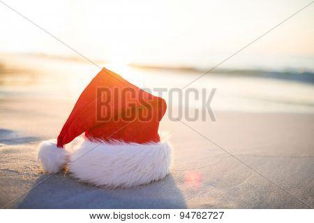 Santa hat on the beach on a sunny day