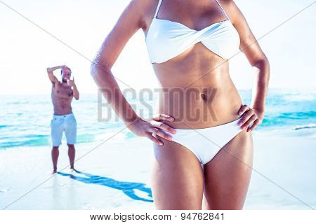 happy man taking a photo of his girlfriends at the beach