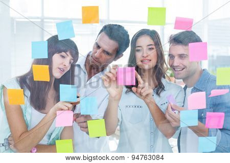 Young creative business people looking at the photo editor at office