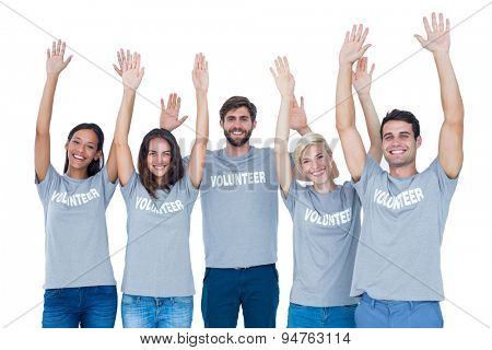 happy volunteers raising their hands