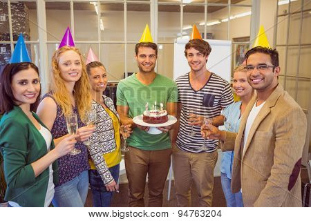 Portrait of creative business people celebrating a birthday