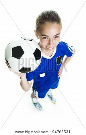 girl in sport wear with football isolated on white background