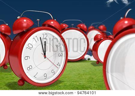 Clocks against moon over field