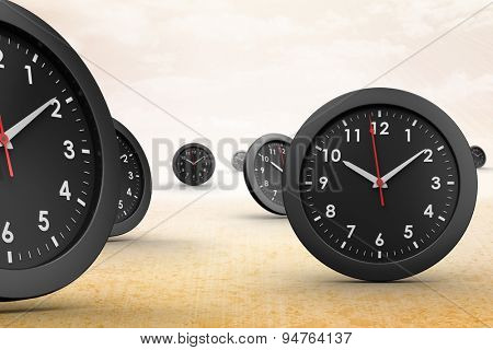 Clocks against sunny yellow background