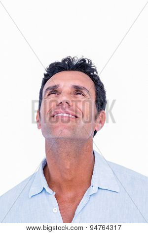 Handsome man looking at top on white background