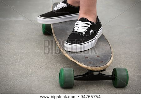 Person standing on a skateboard