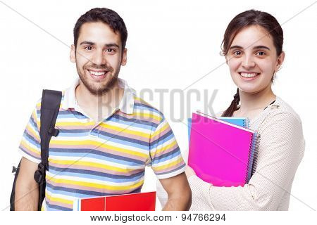 Portrait of happy students standing on white background