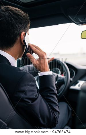 Man using his phone while driving the car