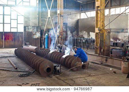 Welders Reparing Ship Parts