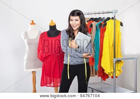 Young Asian Designer Woman Hold A Tablet Pc, Smiling, Look At The Camera