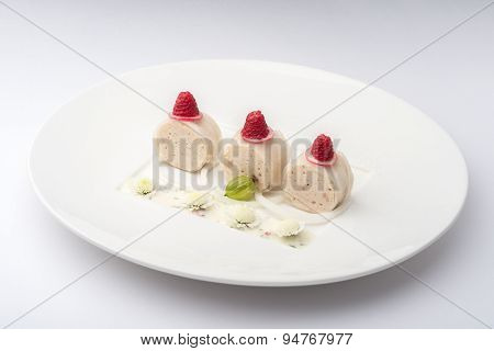 Banana Rolls With Raspberries On A White Plate On A White Background