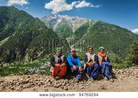 SANGLA, INDIA - JUNE 28, 2012: Indian women of Himachal Pradesh state of India in traditional Kinnaur hats in Himalayas