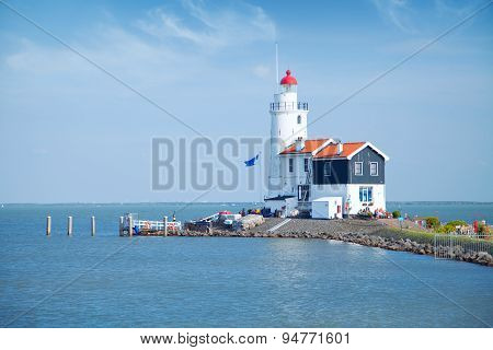 Lonely Lighthouse Stands On The Spit In The Sea Near The Village Of Marken.