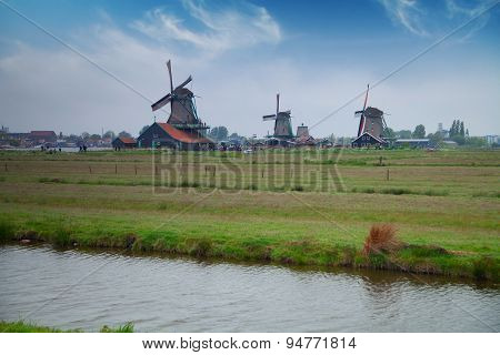 Traditional Dutch Windmills With Canal Near The Amsterdam