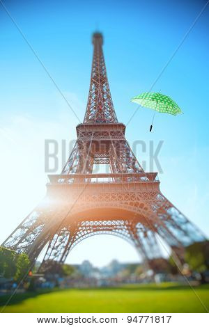 Umbrella Flying Through The Air Against The Backdrop Of The Eiffel Tower. Summer Trip To France