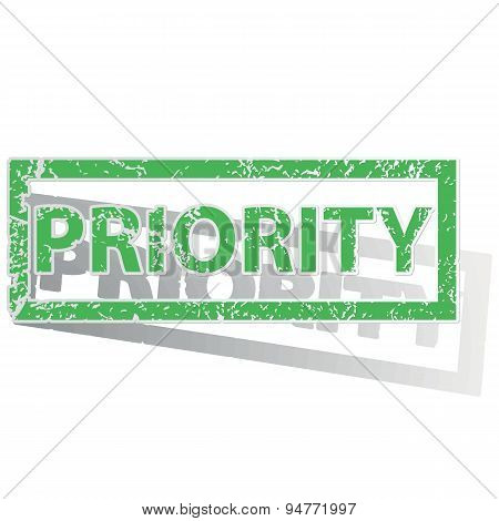 Green outlined PRIORITY stamp