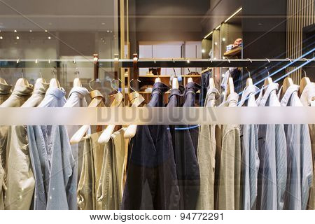 clothes on hanger in modern fashion shop